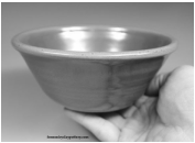 A small handmade pottery bowl in a hand