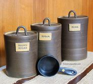 Three piece functional pottery canister set with plaques